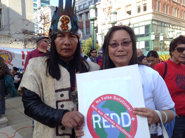 Mr. Ushigua, a Sapara leader from the Ecuadorian Amazon,  and Pam Tau Lee, a veteran Environmental Justice activist, protest REDD at  the SF Climate Justice March, Nov. 21, 2015
